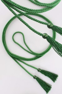 Cingulum with green tassels